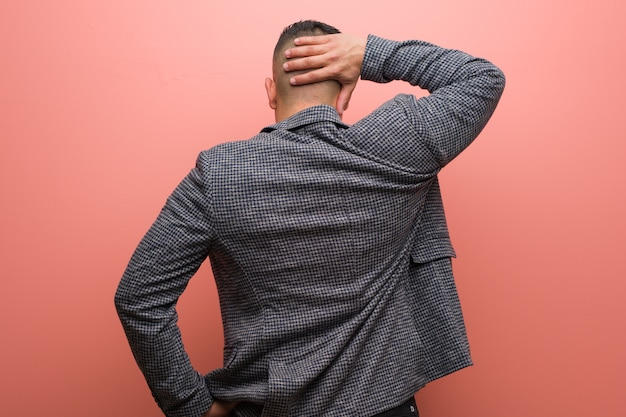 Young elegant latin man from behind thinking about something