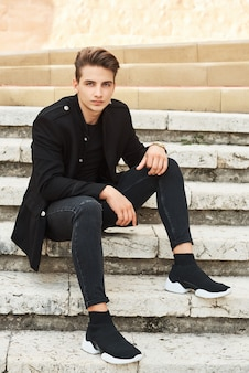 Young elegant man in black clothes