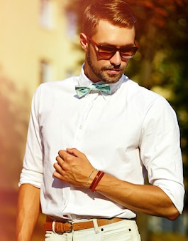 Young elegant man on street