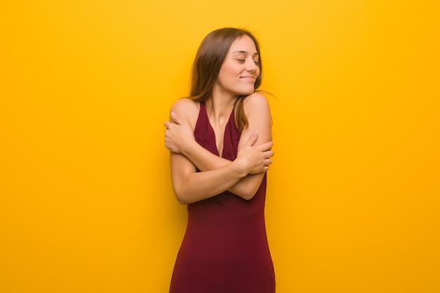 Young elegant woman wearing a dress giving a hug