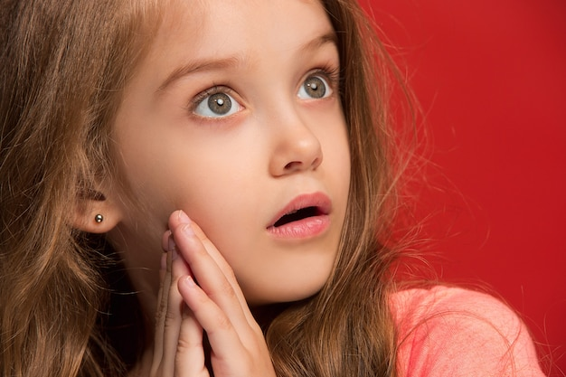 Young emotional surprised girl standing with open mouth
