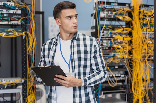 Young engineer in server room