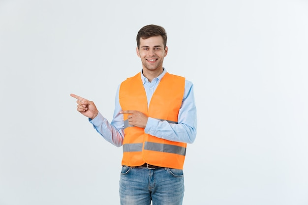 Young engineer smiling isolated on white background.