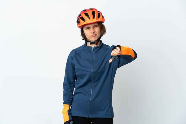Young english cyclist woman on white showing thumb down with negative expression