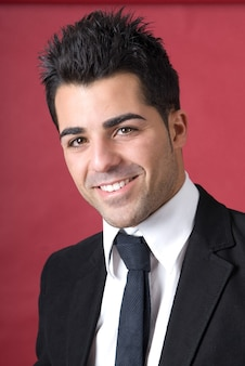 Young enterprising businessman in black suit jacket and tie
