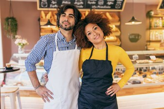 Young entrepreneur couple, they have just opened their bakery.