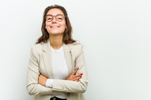 Young european business woman laughing and having fun.