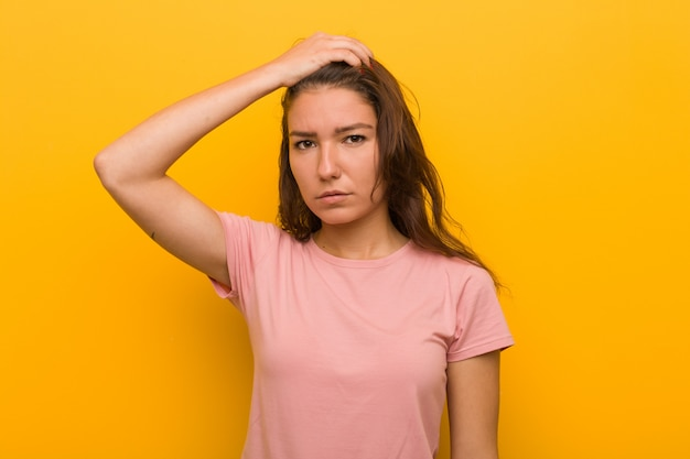 Young european woman isolated over yellow background being shocked, she has remembered important meeting.