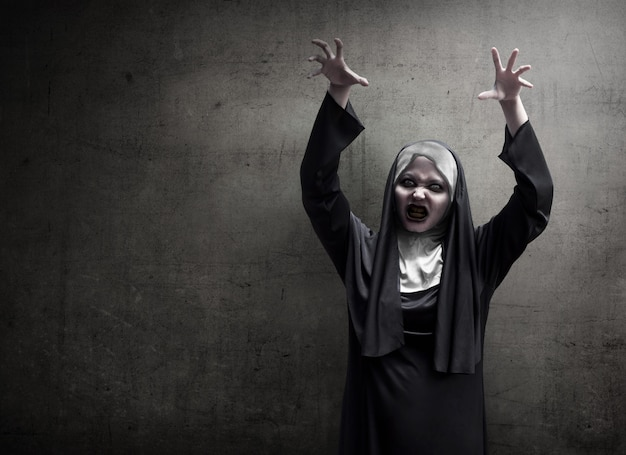 Young evil asian woman nun scare