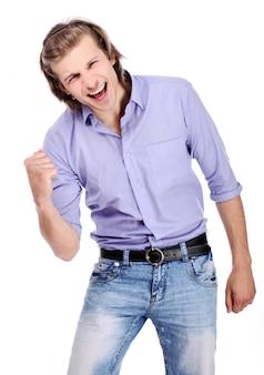 Молодой возбужденный парень над белым