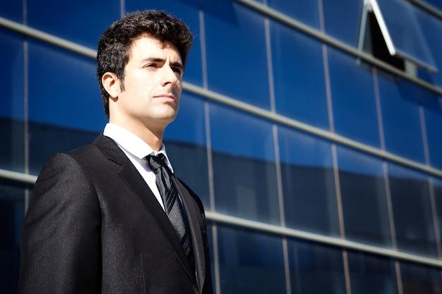 Young executiva man looking at the horizon
