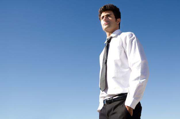 Young executive man looking at the horizon