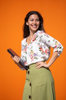 Young executive woman with orange background