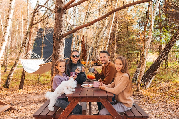 Young family in autumn on picnic. family camping
