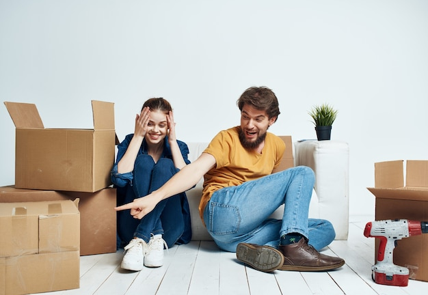 Young family boxes with things moving housewarming