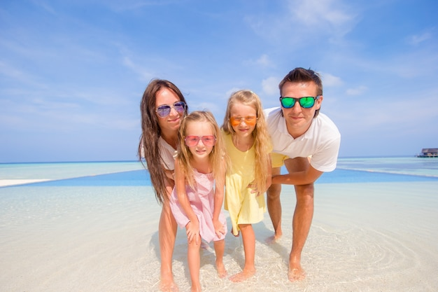 Young family of four on beach vacation. closeup