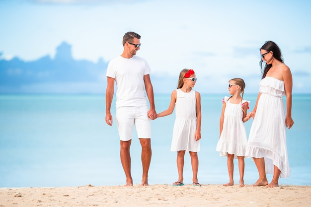Young family of four on vacation have fun