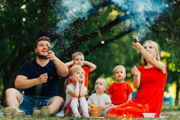 Young family having fun with confetti sprinkles