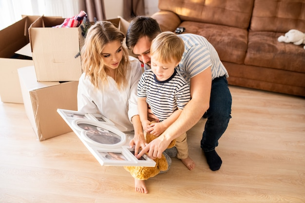 Young family looking at photos