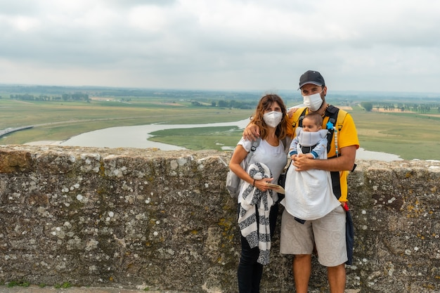A young family visiting the famous mont saint-michel abbey from inside, in the manche department, normandy region, france