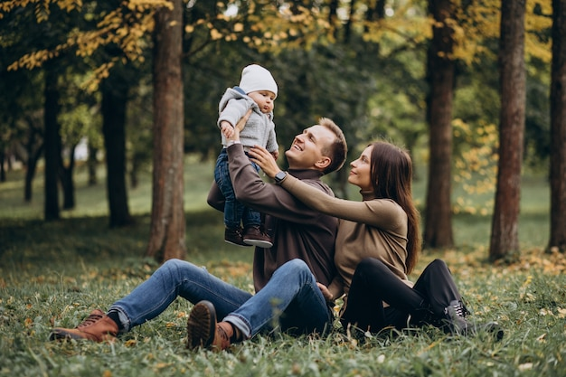 Young family with baby son in park