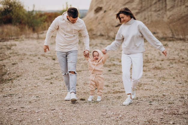 Young family with little son having fun together
