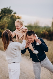 Young family with little son in park