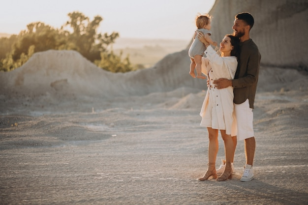 Young family with little son on the sunset