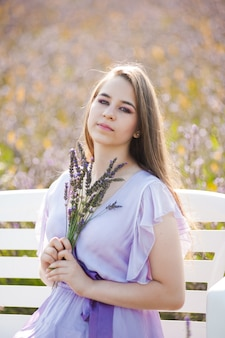 Young fashion woman in long dress outdoor lavender field