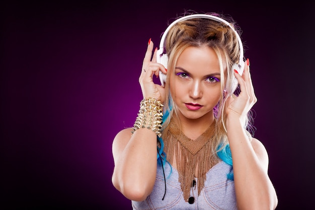 Young fashionable girl in disco style. listening music and enjoying. retro style