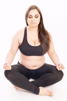 Young fat woman doing aerobic exercise