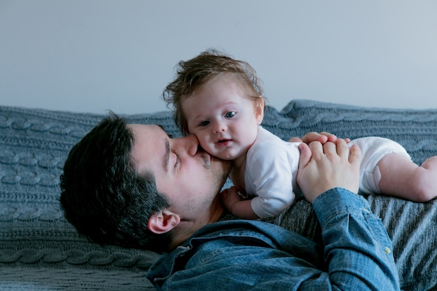 Young father and baby boy at home interior