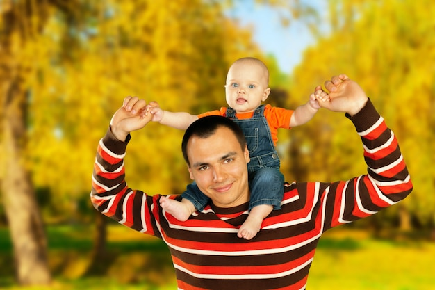 Young father and his smiling son hugging and enjoying time together, father's day celebration