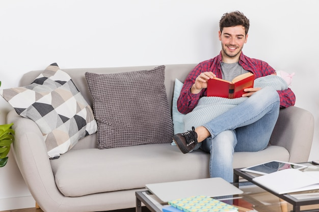 Young father with baby reading book