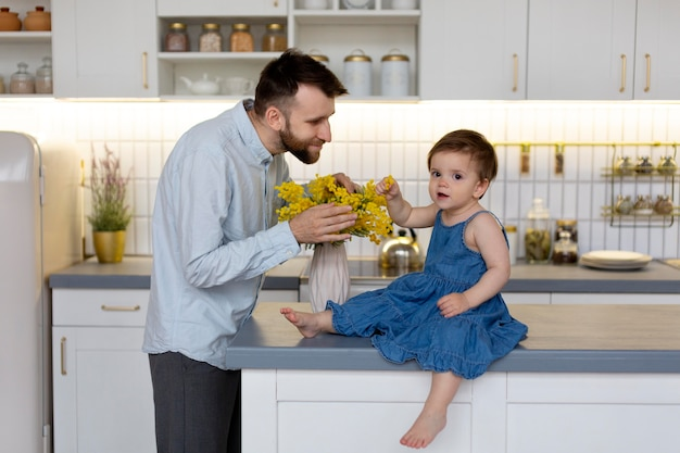 Young father with his baby at home