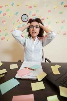 Young female accountant nerves on a limit