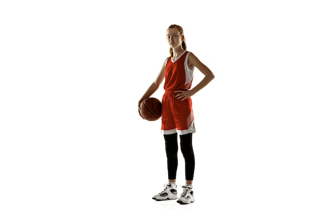 Young female basketball player posing confident isolated on white wall