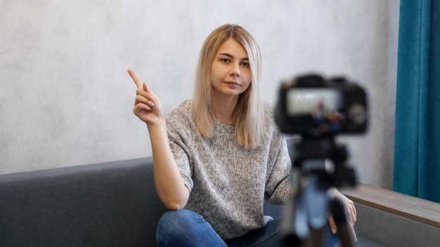Young female blogger talks about business or records a lecture