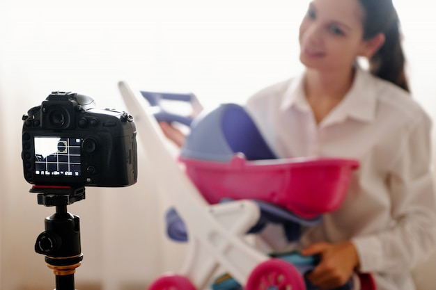 Young female blogger with camera