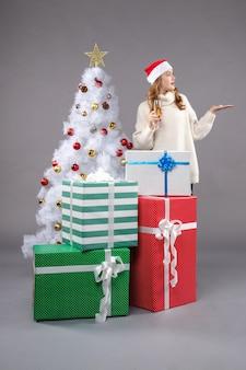 Young female celebrating christmas on light