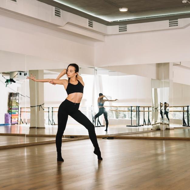 Young female dancer practising in the dance studio