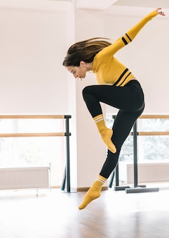 Young female dancer practising in the dance studio