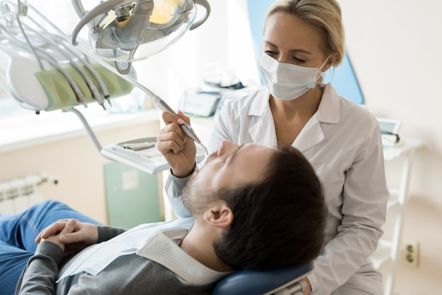 Young female dentist treating patient