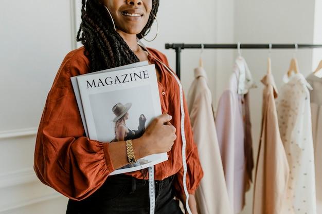 Young female designer holding a fashion magazine