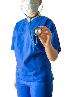 Young female doctor in a blue medical uniform holding a stethoscope isolated on a white background