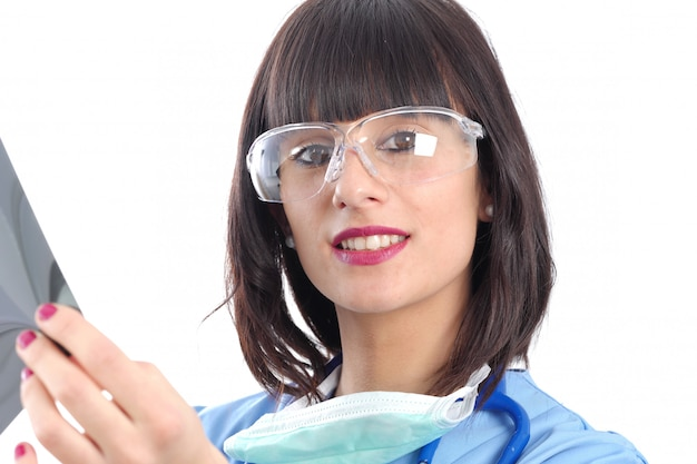 Young female doctor looking at patients x ray