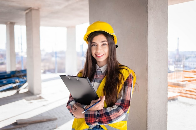 Young female engineer at a construction site