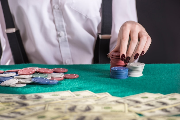 Young female gangster is play poker.