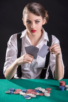 Young female gangster play poker
