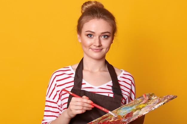 Young female having classes at art studio